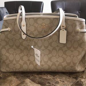 White Coach purse.